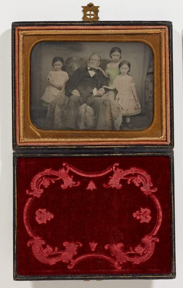 An image of Untitled (portrait of a man and three girls)