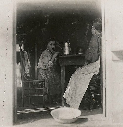 An image of Dinnertime. Family of Mrs A J Young Tifton, GA by Lewis Wickes Hine