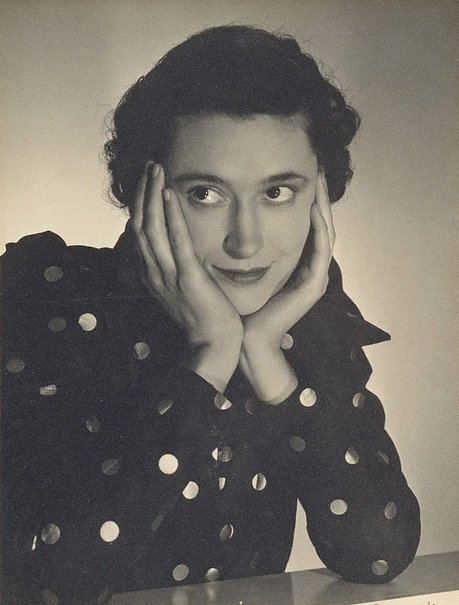 An image of Untitled (Vesta Davies, spotted dress, hands on face) by Max Dupain