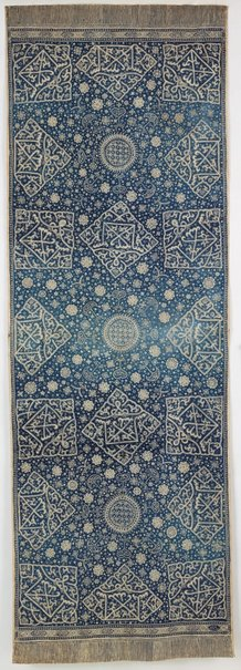 An image of Batik cloth with Islamic inscriptions by