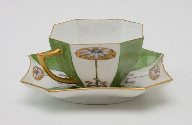 An image of Cup and saucer with flannel flower design