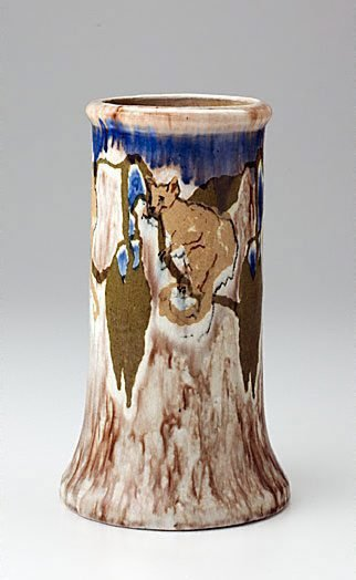 An image of Vase with possums and leaves design