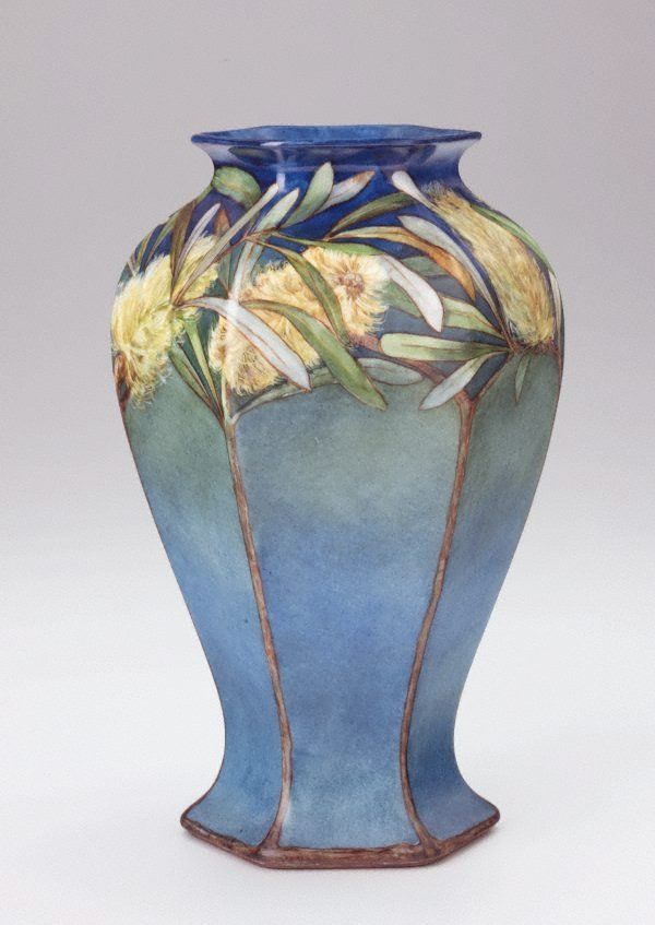 An image of Vase with yellow banksia design
