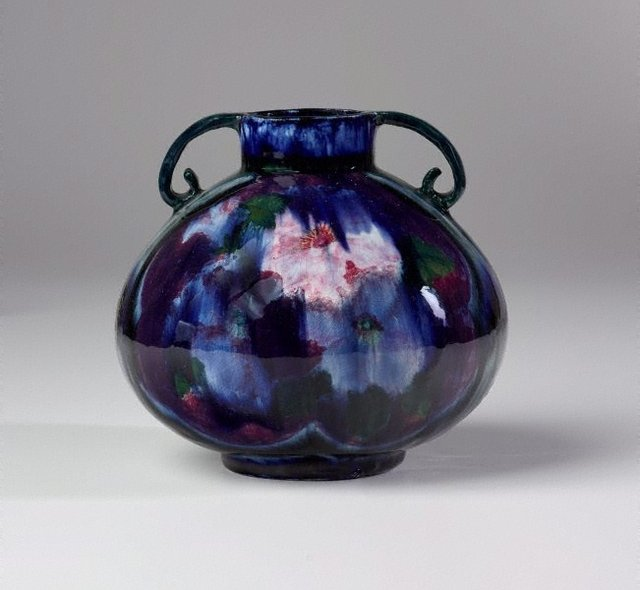 An image of Vase with hibiscus design