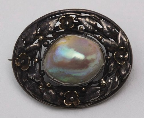 An image of Blister pearl brooch with floral border design by Rhoda Wager