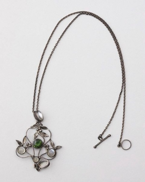 An image of Moonstones and peridot pendant and chain by attrib. Rhonda Wager