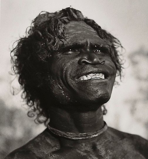 An image of Narrana, at sun up, daubed with clay. Liverpool River Arnhem Land by Axel Poignant