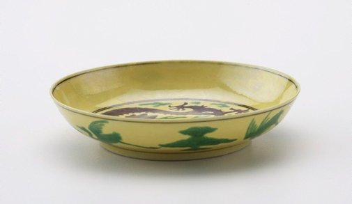 An image of Yellow-ground dish decorated with green and aubergine dragons by