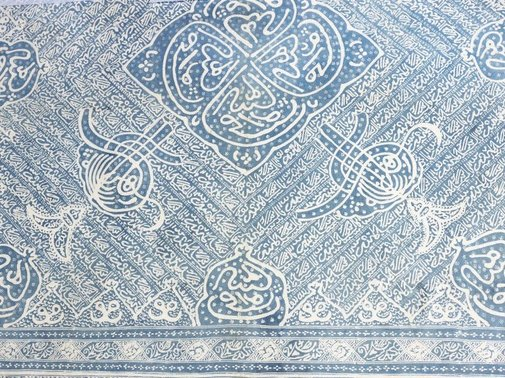 An image of Batik head cloth with Islamic calligraphy design by