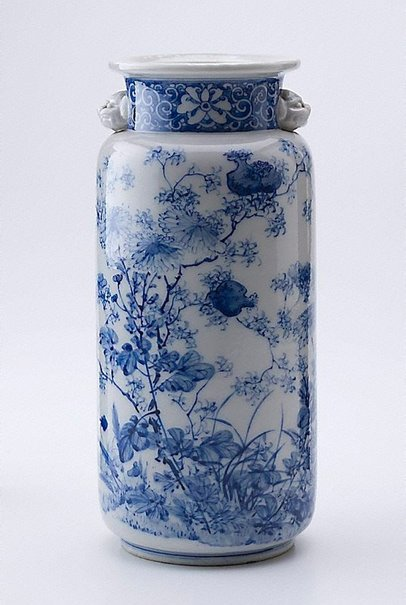 An image of Blue and white vase with design of pomegranate and chrysanthemum by Meiji export crafts