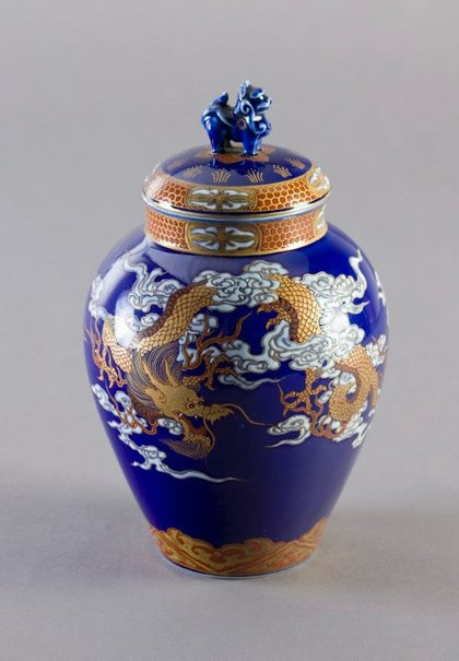 An image of Tea jar with design of dragon and pheonix in clouds by Fukagawa Porcelain Manufacturing Co., Ltd