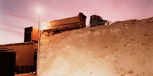 An image of Truck waiting to dump a load of gypsum into the crusher's hopper by Ed Douglas
