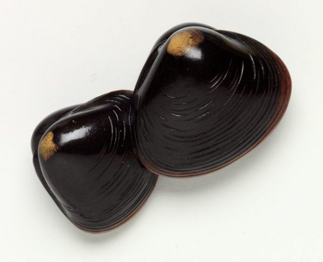 An image of Netsuke in the form of two clam shells