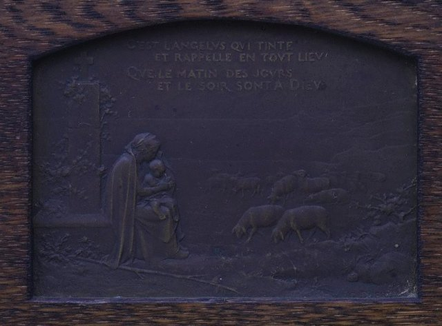 An image of recto: It is the Angelus sounding (C'est l'Angelus qui tinte) verso: A ploughing farmer, accompanied by his dog, stops to pray