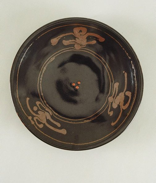 An image of Plate with tenmoku glaze and iron glaze decoration with three red dots by SHIGA Shigeo