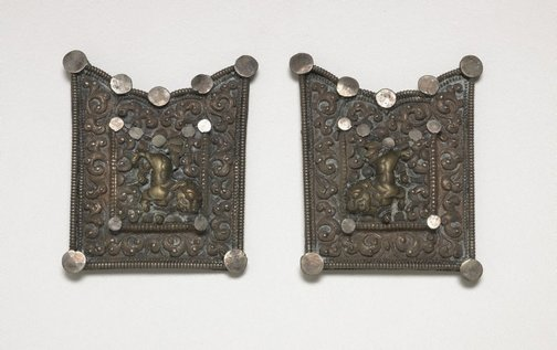 An image of A two part belt buckle or harness fitting depicting a pair of snow lions by