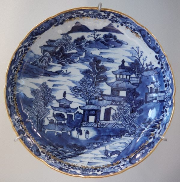 An image of Plate decorated with castle and landscape scene