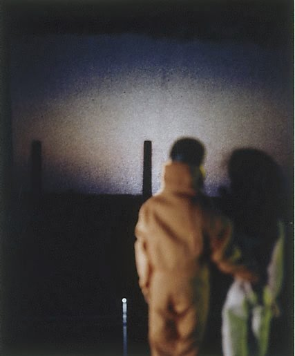 An image of Untitled (Ken and Barbie, smokestacks) by Anne Zahalka
