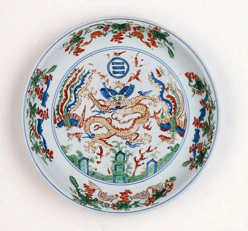 An image of 'Wucai' dish decorated with dragon and two phoenixes above the Immortal Isles in the Eastern sea by Jingdezhen ware