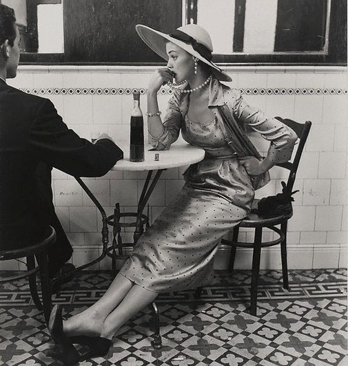 An image of Vogue fashion photograph, Café in Lima, Peru (Jean Patchett) by Irving Penn
