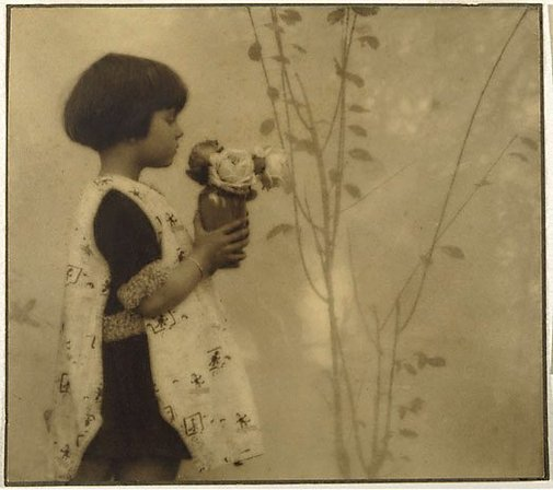An image of Child and roses by Alfred Chambers