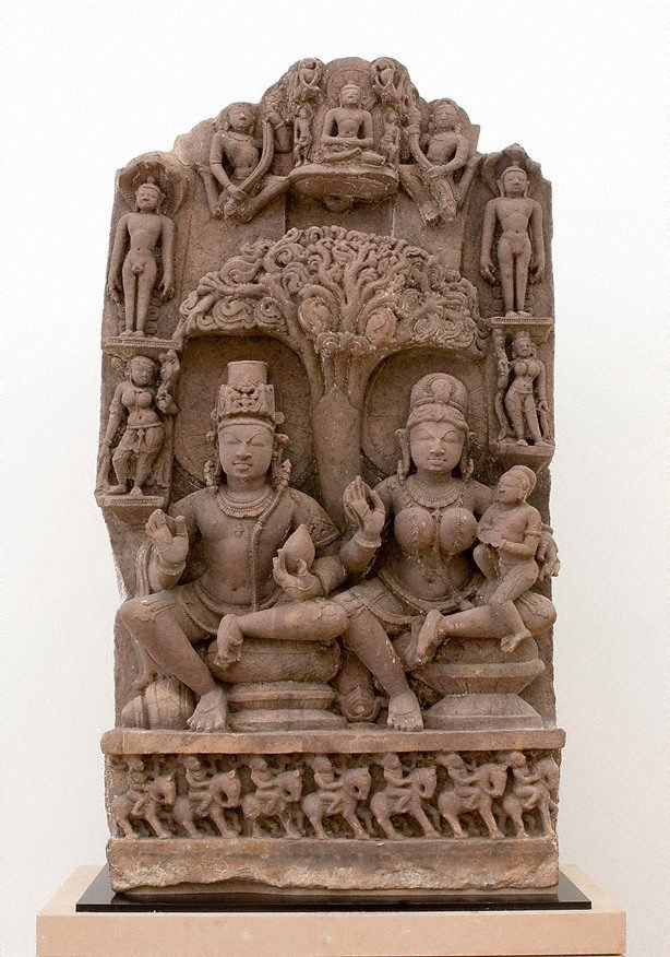 An image of Stele with 'yaksha-yakshini' couple and Jinas