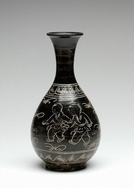 An image of Cizhou ware vase with incised design of children playing amidst grasses by Cizhou ware
