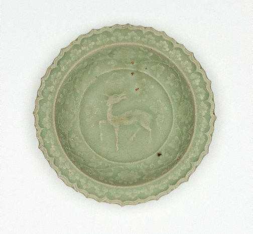 An image of Saucer dish with slip design of antelope and foliate edge by Longquan ware