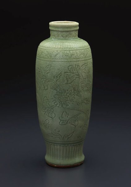 An image of Vase of slender baluster shape with carved floral design by Longquan ware