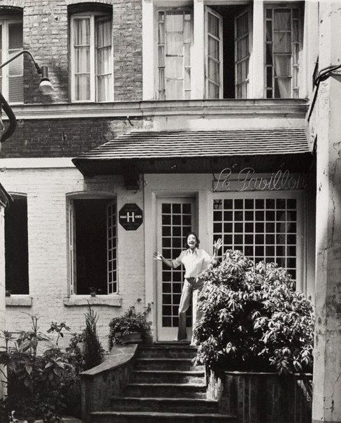 An image of Untitled (woman on the doorstep of 'Le Pavillon' hotel) by Max Dupain