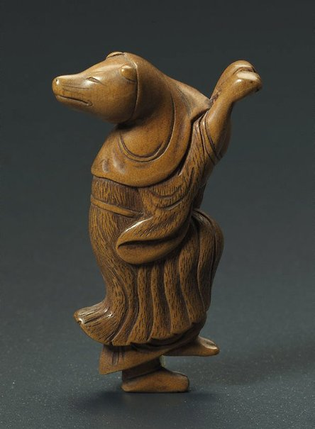 An image of Netsuke in the form of a fox disguised as a woman dancing by