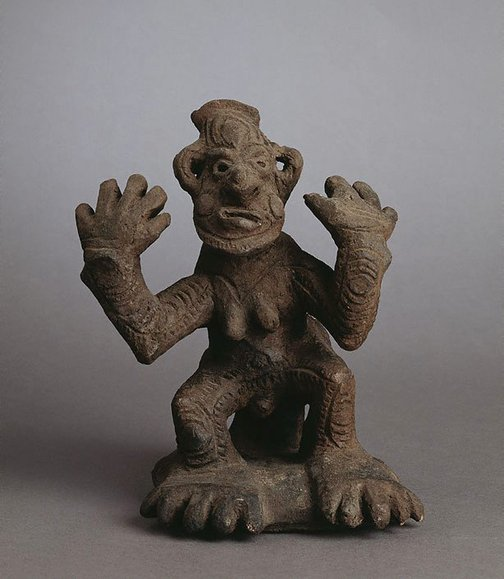 An image of Yaul male figure with hands raised by
