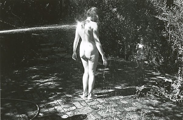 An image of Joanie being hosed and Raven, Summer 1973