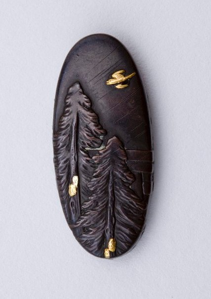 An image of kashira (with design of fir trees and bird in flight) by