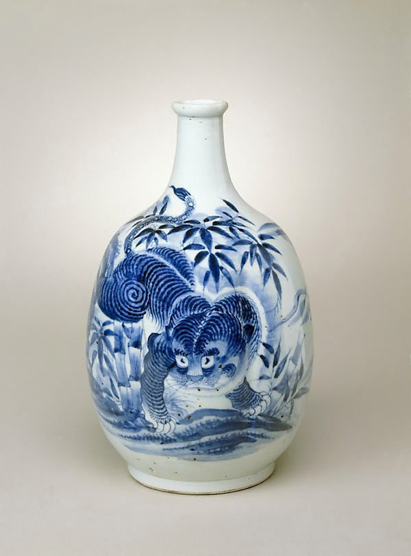 An image of Multi-lobed sake bottle with design of tiger