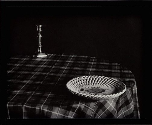 An image of Plate on table edge by Catherine Rogers