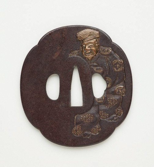 An image of tsuba (with design of old man) by