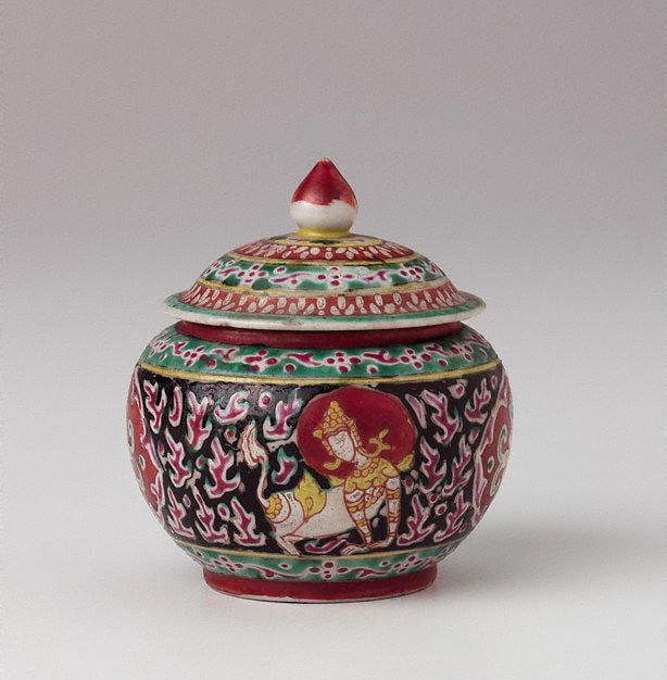 An image of Covered jar decorated with one thepanom, one rorasingh, two cartouches, each separated by Chinese flame patterns