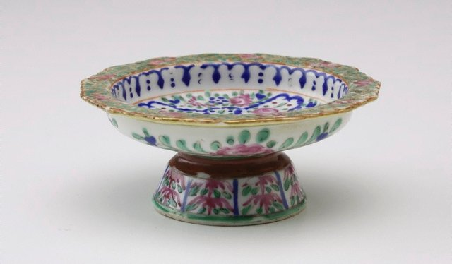 An image of Tazza decorated on front with pink roses on blue surrounds, with three pink roses on underside