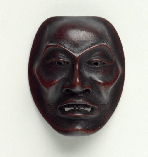 An image of Netsuke in the form of a Noh mask of 'yase-otoko' (thin man) by