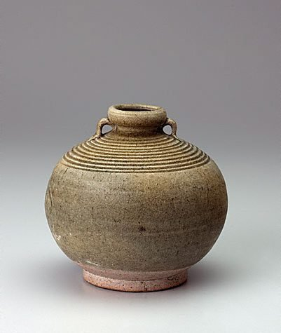 An image of Two handled globular jar with incised concentric rings on shoulder