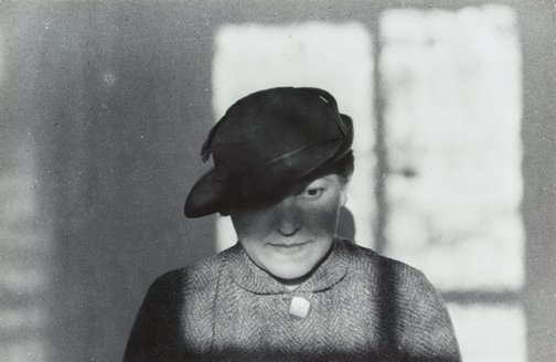 An image of Untitled (Stepanova in hat) by Aleksandr Rodchenko