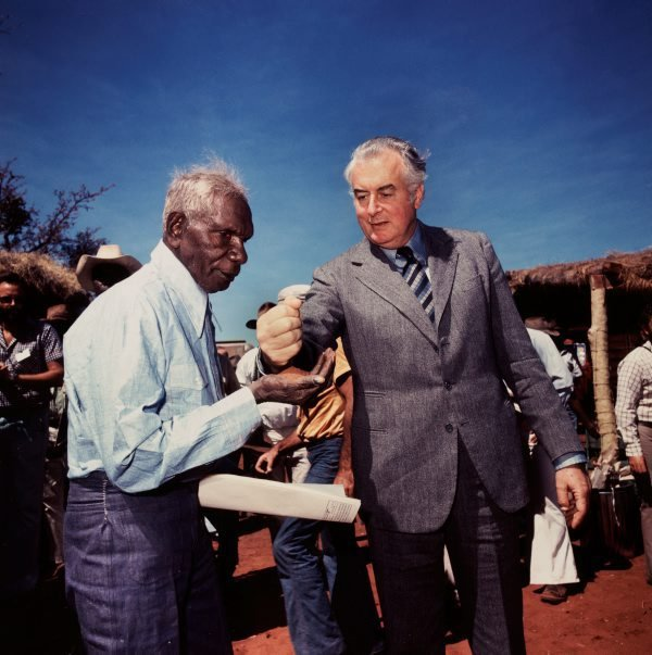 An image of Prime Minister Gough Whitlam pours soil into the hands of traditional land owner Vincent Lingiari, Northern Territory