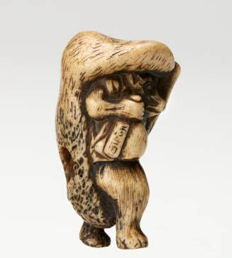 An image of Netsuke in the form of a badger carrying a 'sake' bottle