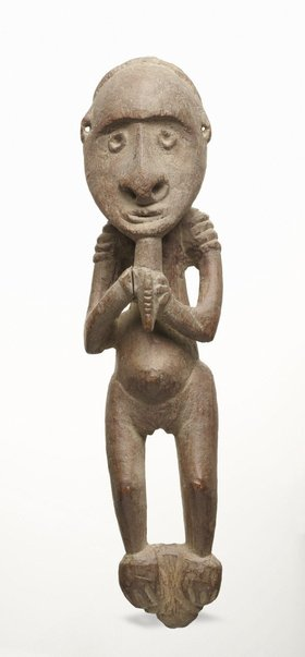 An image of Female figure holding object to chin by