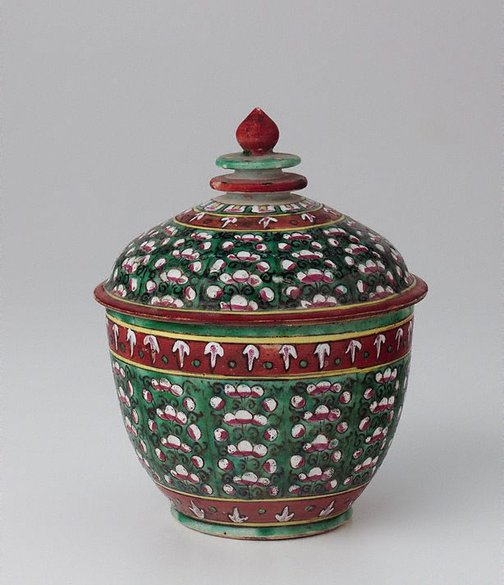 An image of Toh jar decorated with coloured flowers in vertical patterns by Bencharong ware