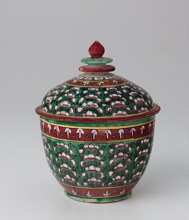 An image of Toh jar decorated with coloured flowers in vertical patterns