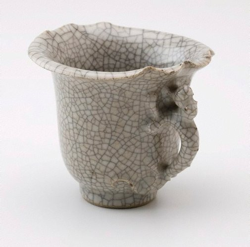 An image of Cup in the shape of a rhinoceros horn with a dragon shaped handle by
