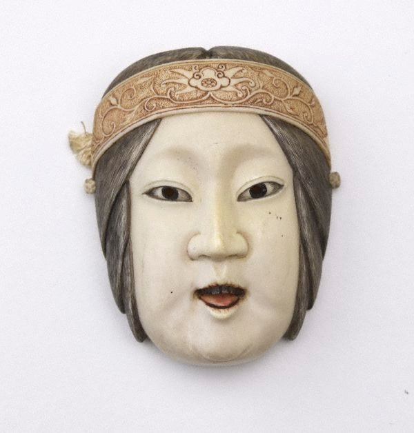 An image of Netsuke in the form of a female Nô mask