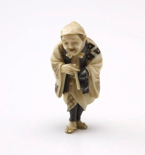 An image of Netsuke in the form of an old man by Gyokuzan